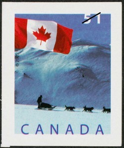 A dogsled in the St. Elias mountain range, Yukon Canada Postage Stamp | Flag