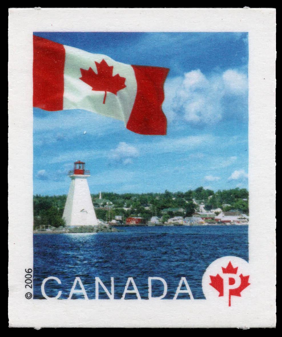 The lighthouse at Bras d'Or Lake in Nova Scotia Canada Postage Stamp | Flag