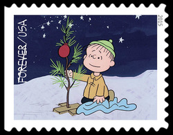 Linus Kneeling by the Sparsely Decorated Christmas Tree United States Postage Stamp | A Charlie Brown Christmas