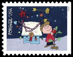Charlie Brown Decorating Tree in Front of Snoopy's Doghouse United States Postage Stamp | A Charlie Brown Christmas